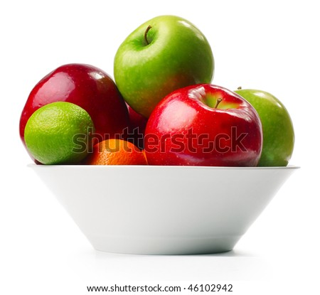 Fruits in deep plate over white