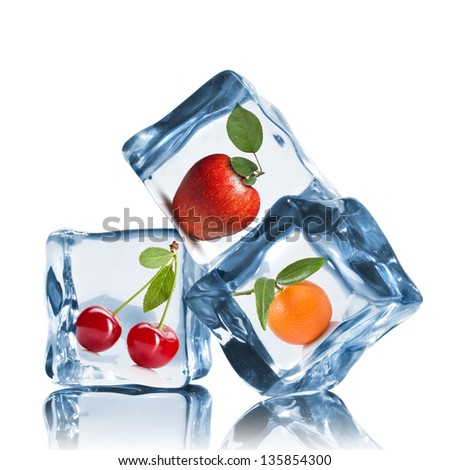 fruits in ice cubes isolated on white - stock photo