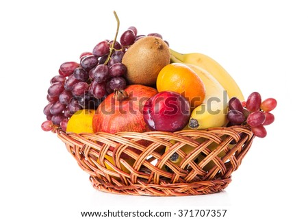 Fruits  in the basket. assorted fruits in wicker basket