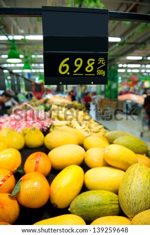 Fruits in the supermarket in China. - stock photo