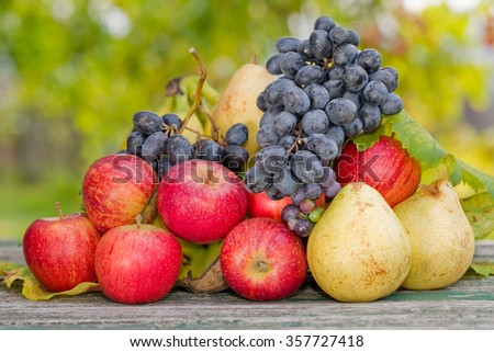 fruits in wooden table outdoor in the garden - stock photo