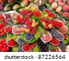 Fruits market (La Boqueria,Barcelona famous marketplace). Red and black berries - stock photo