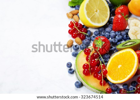 Fruits on Marble Background. Summer or Spring Organic Fruits. Agriculture, Gardening, Harvest Concept - stock photo