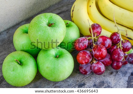 fruits on old table, cement background.