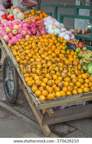 Fruits on wood cart at street in Laos