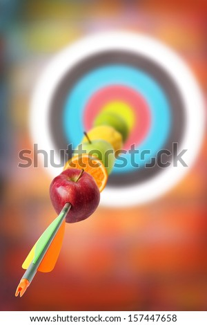 Fruits placed in arrow at the target. Concept for vitamins diet. - stock photo