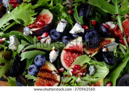 fruits salad with figs and blueberries, food top view - stock photo