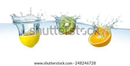 fruits splashing into the water