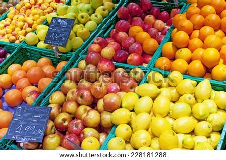 Fruits stall in La Boqueria, the most famous market in Barcelona.  - stock photo