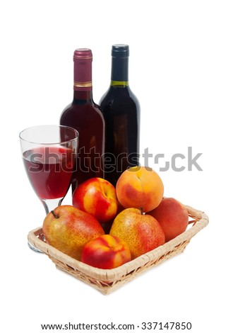 Fruits, wine bottles and a wine glass on a white background