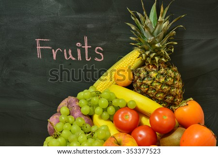 fruits with black blackboard and text