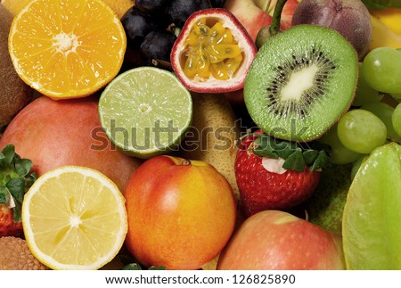 Fruity background of many different fruits - stock photo