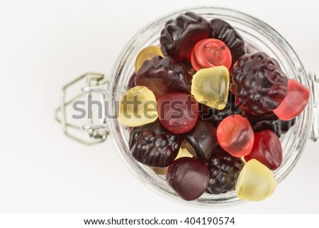 fruity gummy candies in a glass jar - stock photo