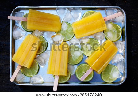 Fruity popsicles with ice and lime - stock photo