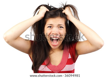 Frustrated and angry mad woman going crazy hands pulling her hair. Isolated on white background