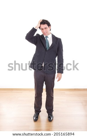Frustrated and depressed businessman with headache holding his head with hand - stock photo