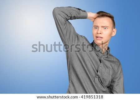 Frustrated and nervous young man - stock photo