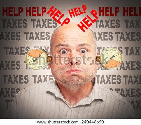 Frustrated and stressed businessman under pressure. High taxes concept. - stock photo