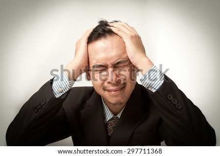 Frustrated asian aged businessman. - stock photo