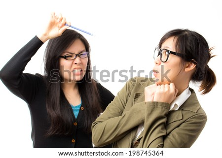 Frustrated asian woman holding eggs shooting in white background - stock photo