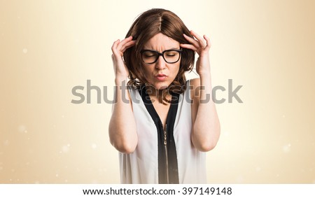 frustrated Brunette woman  over ocher background - stock photo