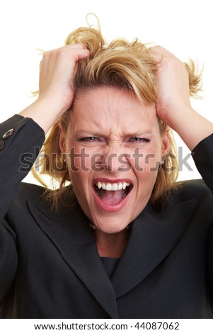 Frustrated business woman pulling her hair and screaming - stock photo