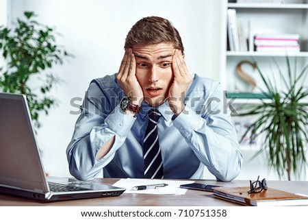 Frustrated businessman dissatisfied his earnings. Photo of young man working in the office. Business concept