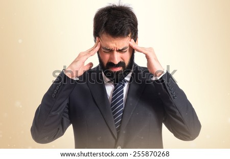frustrated businessman over ocher background - stock photo