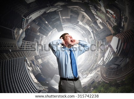 Frustrated businessman screaming and covering his ears with hands - stock photo