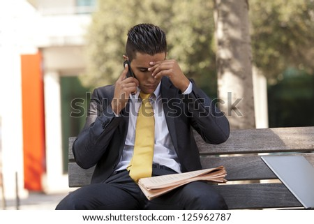 frustrated businessman sit at the bench park