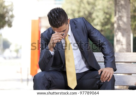 frustrated businessman smoking a cigar to relax - stock photo