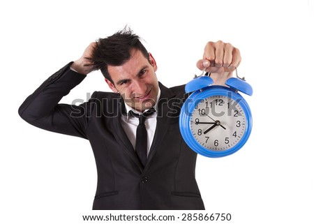 frustrated businessman with alarm - stock photo