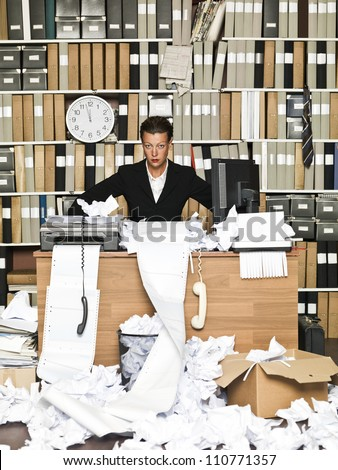 Frustrated Businesswoman at a messy office