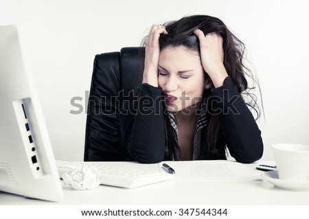 Frustrated Businesswoman In The Office