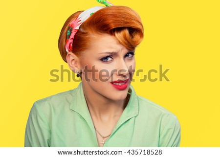 Frustrated Closeup portrait headshot skeptical young lady woman girl looking suspicious disgust on face mixed with disapproval isolated yellow background.Negative human emotion face expression feeling - stock photo