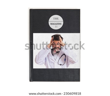 Frustrated doctor with pills printed on book - stock photo
