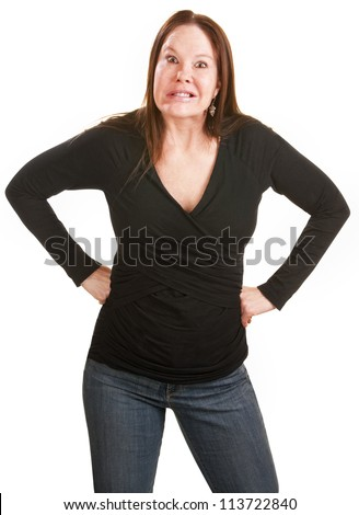 Frustrated European woman in black with hands on hips - stock photo