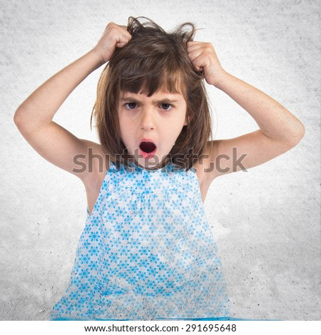 frustrated girl over grey background