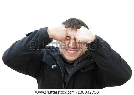 Frustrated guy on a white background - stock photo