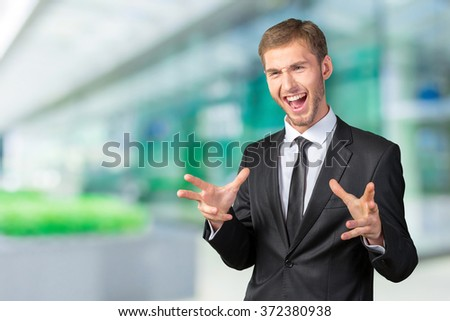 Frustrated handsome young businessman - stock photo