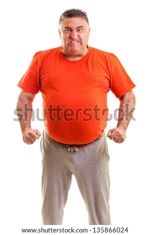 Frustrated man clenching his fist against white background - stock photo