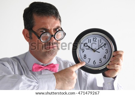 Frustrated man manager points to the time on a clock. Business concept. real people copy space on white background