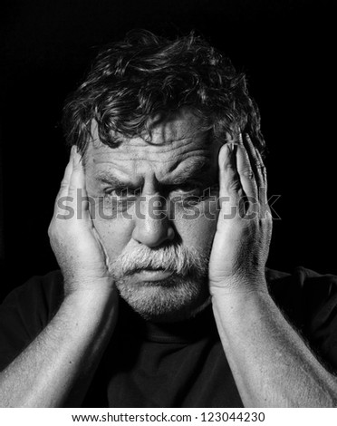 frustrated man put his hands on his head - stock photo