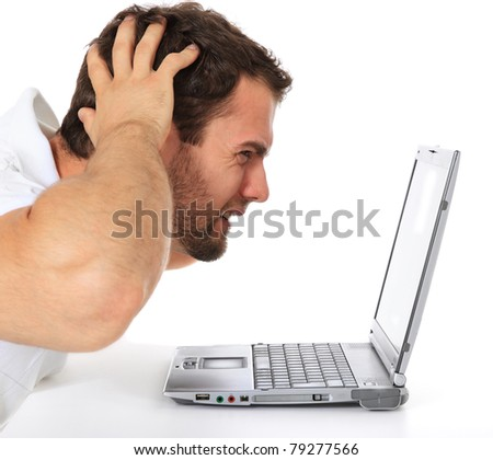 Frustrated man sitting in front of his laptop. All on white background.