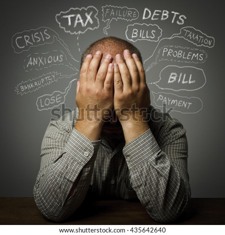 Frustrated man. Taxes, debts and other problems.