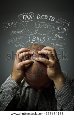 Frustrated man. Taxes, debts, credits and other problems. Man in thoughts.