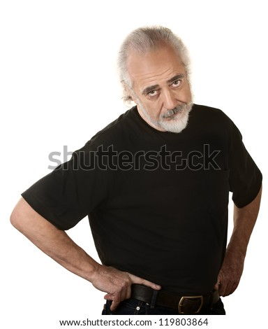 Frustrated older man in beard and hands on hips - stock photo