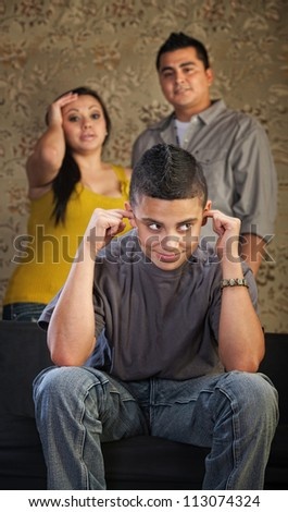 Frustrated parents and child with ears plugged - stock photo