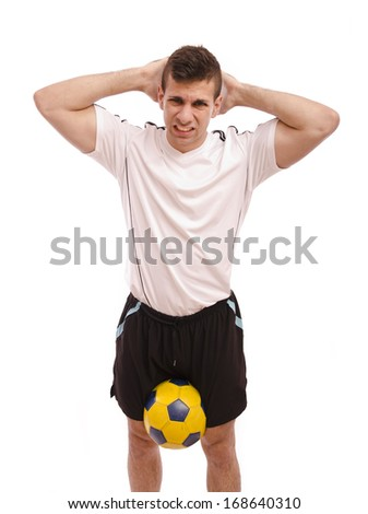 Frustrated soccer player isolated on white background
