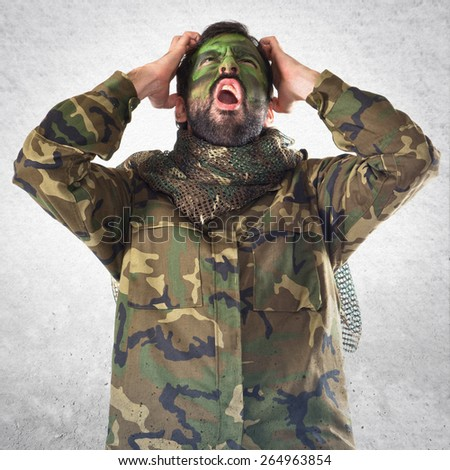 frustrated soldier over white background  - stock photo